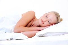 Young sleeping woman seeing sweet dreams Royalty Free Stock Photos