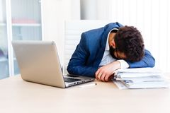 Young Sleepy Businessman Sitting At Workplace. Young Sleepy Business Man Sitting At Workplace - In office Stock Photos