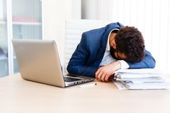 Young Sleepy Businessman Sitting At Workplace. Young Sleepy Business Man Sitting At Workplace - In office Stock Photo