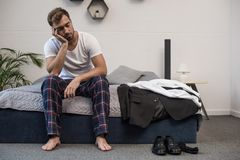 Free Young Sleepy Man In Home Clothes Sitting On Bed After Waking Up Royalty Free Stock Photography - 118821137