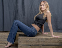 Free Young Slender Blonde Girl In Jeans And Shirt Posing Coquettishly Royalty Free Stock Images - 82691759