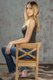 Young slender blonde girl in jeans and shirt posing coquettishly Stock Images
