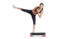Young slender brunette exercising on stepper Stock Photo