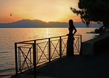 Girl, evening and sea Stock Image
