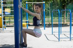Young slender Lady engaged in fitness Royalty Free Stock Image
