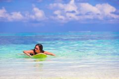 Young slender surf girl at white beach with yellow Stock Image