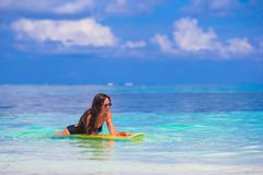 Young slender surf girl at white beach with yellow Stock Photos