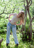 Young slender woman does sporting training in park. The young slender woman does sporting training in park Royalty Free Stock Photography