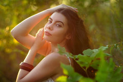Girl in a light dress in the forest. Royalty Free Stock Photo