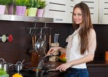 Woman prepares vegetables Stock Photo