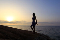 Young slender woman silhouette at sunrise Stock Photos