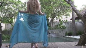 Young slender woman to bikini going to the swimming pool on tropical the resort of Bali Indonesia.  stock video footage