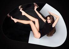 Young slim beautiful lady in abstract plastic tube royalty free stock photo