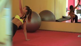 Young slim blonde sports girl training in a gym. Healthy lifestyle stock video footage