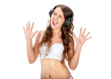 Young slim brunette girl listen music in headphones Royalty Free Stock Images