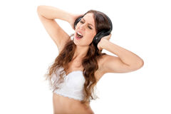 Young slim brunette girl listen music in headphones Royalty Free Stock Photos