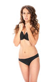 Young slim brunette girl posing in a studio in lacy underwear Royalty Free Stock Photo