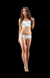 Young slim brunette girl posing in a studio in lacy underwear Royalty Free Stock Photos