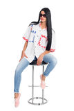 Young slim elegant woman sitting on a chair Stock Photo