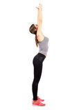 Young slim and fit woman stretching back with arms raised up Royalty Free Stock Photography