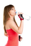 Young slim fitness girl drinking fresh water from bottle Stock Photography