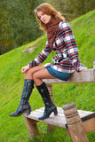 Young slim girl in a park Stock Images