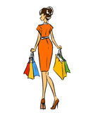 Young slim girl in short dress with shopping bags Royalty Free Stock Photos
