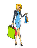 Young slim girl in short dress with shopping bags Stock Photography