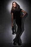 Young slim glamour lady with long hairs in black Stock Photography