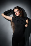 Young slim glamour lady with long hairs in black Stock Photos