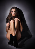 Young slim glamour lady with long hairs on black Stock Images