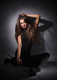 Young slim glamour lady with long hairs in black Royalty Free Stock Images