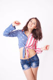 Young slim joyful girl. In shorts and a shirt Royalty Free Stock Photo