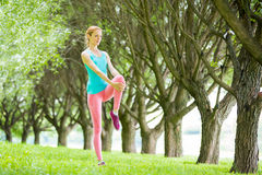 Young slim lady training in the park Stock Image