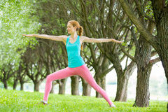 Young slim lady training in the park Stock Photos
