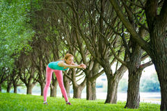 Young slim lady training in the park Royalty Free Stock Photo
