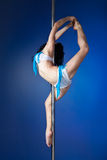 Young slim pole dance woman doing exercise Stock Image