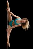 Young slim pole dance woman exercising Royalty Free Stock Photo