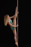 Young slim pole dance woman exercising Stock Images