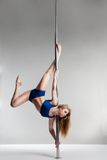 Young slim pole dance woman exercising over white Royalty Free Stock Photography