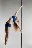 Young slim pole dance woman exercising over white Stock Image