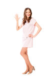 Young slim pretty woman in pink dress posing Stock Images