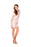 Young slim pretty woman in pink dress posing Stock Photography