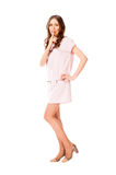 Young slim pretty woman in pink dress posing Stock Photos