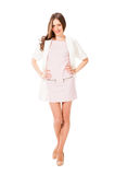 Young slim pretty woman in pink dress posing Stock Image