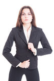 Young slim and sexy business woman adjusting suit jacket Stock Photo