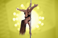 Young slim sexy pole dance woman Royalty Free Stock Images