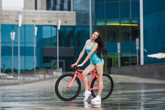Young slim sexy sportive woman on bicycle Royalty Free Stock Images