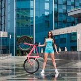 Young slim sexy sportive woman on bicycle Stock Images