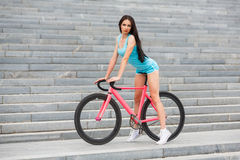 Young slim sexy sportive woman on bicycle Royalty Free Stock Photos